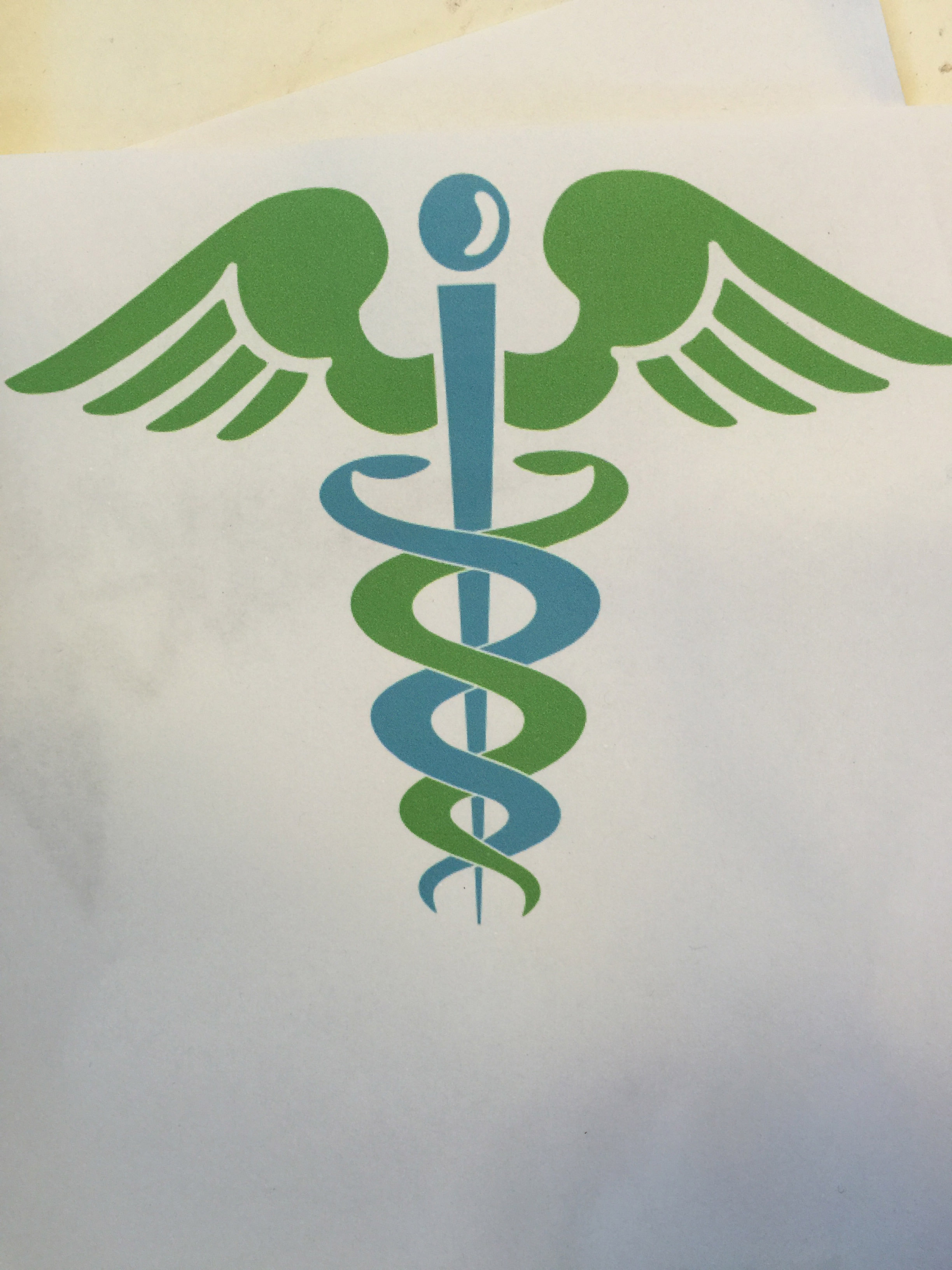 The Caduceus, symbol of medicine, is painted to go around this post.